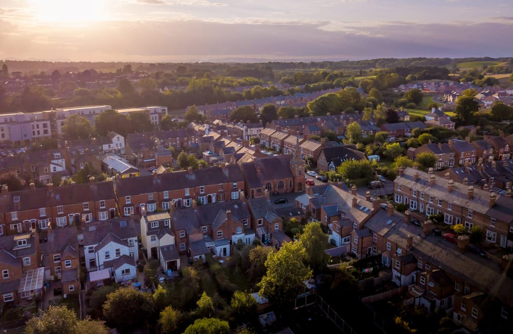 Aerial view houses and sunset